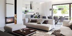 Projekt domu HomeKONCEPT 58 #projektdomu #homekoncept #płakidach #domnowoczesny #architektura #design #jasnaelewacja #nowoczesnałazienka #czarnaściana #białasofa #dużeprzeszklenie #dużeokna
