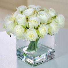 Jane Seymour Botanicals Rose Buds in Square Glass Vase $145.47 for simple snipped artificial bud roses, white with light peach or yellow centers in clear acrylic water.  I really want to do this.!!!!!!!