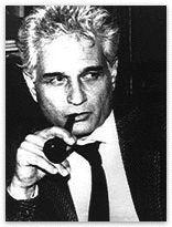Jacques Derrida smoking a pipe.
