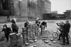 """Children playing at """"building the Wall"""". West Berlin, Germany, 1962"""