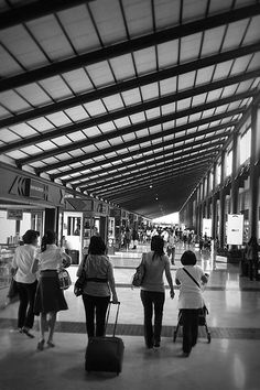 Soekarno-Hatta Jakarta International Airport. @ Soekarno-Hatta Jakarta International Airport.  Taken months ago while I am on my way for work.. waiting for my flight from Jakarta to Banjarmasin. Came across a lovely corner.. and took some shots.. I love the roof of the airport. However, the whole airport setting is very dim..