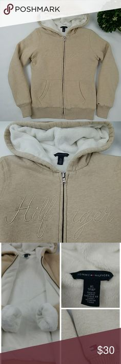 "Tommy Hilfiger plush zip up hoodie womens Tommy Hilfiger plush zip up hoodie womens. Very warm and comfortable. Plush lining throughout the inside even inside the sleeves. The color is beige/cream/tan with white lining. In great clean condition. Body: 86% cotton 14%polyester Lining:100%polyester Armpit to armpit laying flat 18"" Waist 15.5"" laying flat Length 23"" Tommy Hilfiger Tops Sweatshirts & Hoodies"
