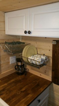 dish drainer also storage (notice bread pan underneath to catch drips) For Michael - drainer is their storage 2in1                                                                                                                                                     More