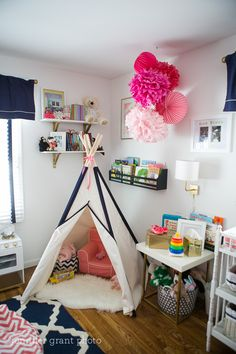 Teepee and fun play nook in a coral and navy toddler girls room!