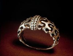 Bangle. Silver, solid cast, with deep relief ornamentation; L. 8.6cm. Found: Orupgard, Falster, Denmark.