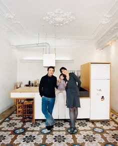 Cecilia Tham + Yoel Karaso of Habitan Architects and their adorable daughter! in their kitchen. Photo by: Gunnar Knechtel  Read more: http://www.dwell.com/articles/Everything-Must-Go.html