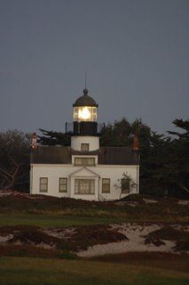 Pacific Grove, California.  When it is really, really foggy there is a road up behind the lighthouse which has 2 white posts at the end of a driveway, which look like 2 white ghosts.  All the teens who drove back in the day go for a look.