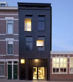 Rotterdam's Black Pearl - Part of a program in Rotterdam to revitalise disadvantaged neighbourhoods.  The 100-year-old façade of the dwelling was painted black, and masonry, frames and windows were covered in shiny black oil creating a 'shadow' of the original façade.   The project was a collaboration between Zecc Architecten and Studio Rolf.