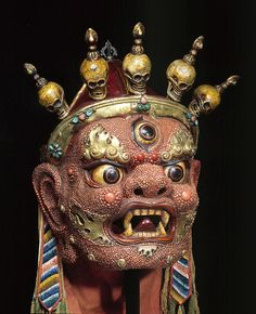Mongolia; Mask of Begtse; circa early 20th Century; papier-mâché, coral, metal, and fabric