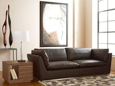 Contemporary styling coupled with rich brown leather make the Amani Sofa both a focal point of your living room and the perfect place to sit and relax.