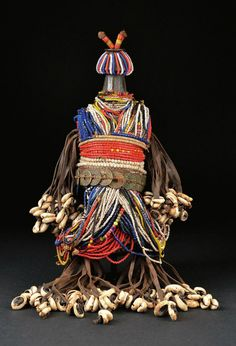 Africa | Fali doll from northern Cameroon | Wood, glass beads, coins, cowrie shells, leather strips, coins, cotton threads