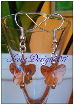 Beautiful Handmade Silver Hook Earrings with Light Orange Crystal Butterflies All kind of Crystal helps us to see more clearly and I just love these butterflies Would you like to wear these earring…