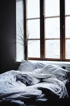 bare branch arrangement // bedroom with big windows // grey bedding