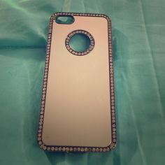 iPhone 5s case This case has rhinestones bordering the case itself and the the circle that surrounds the apple symbol. No stones missing Accessories Phone Cases