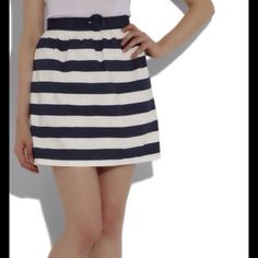 Striped Navy and White Skirt Very cute skirt, no belt included, shows normal signs of wash and wear slight fading. Alice + Olivia Skirts Mini