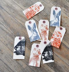 Adorable animal tags, screen printed from fantastic drawings of an owl, bear, rabbit and porcupine!
