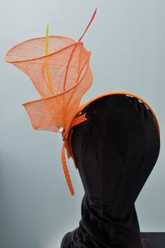 Items Similar To Orange Sinamay Fascinator On Headband With Beads Feathers And Ribbon Etsy