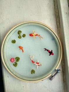 fabulous floral embroidery designs Tries to make an organza koi pond: embroider, make a koi pond or .Tried to make an organza koi pond: embroidery, tried making a koi pond Hand Embroidery Stitches, Embroidery Hoop Art, Cross Stitch Embroidery, Embroidery Ideas, Hand Stitching, Knitting Stitches, Simple Embroidery, Embroidery Fashion, Embroidery Techniques