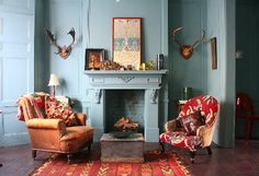 perfect shade of robins' egg blue for walls and fireplace plus rusty red for rugs and upholstery.
