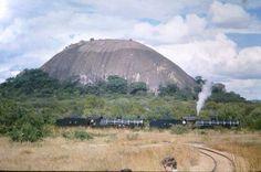 Rhodesia Railways locos alongside a granite kopje. Lest We Forget, Zimbabwe, Present Day, Amazing Places, Civilization, Granite, Afro, Beats, Trains