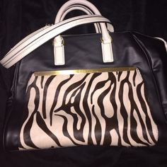 Calvin Klein handbag. Excellent condition. Like new! Stunning! Black and white zebra print on outside pocket-CK handbag. Double strap and double zipper. Three inside pockets one is with a zipper. Dare to be different. Calvin Klein Bags Satchels