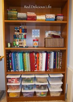 """The fabric stash of the """"Red Delicious Life"""" blogger. There are more pics of her studio at the source as well as discussion about how one thing leads to another when we start to organize our craft spaces."""
