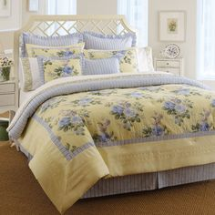 Escape to a bed and breakfast in your own bedroom. Caroline #Bedding by Laura Ashley infuses the room with cheerfulness and beauty. The blue floral design on a yellow background is trimmed by a border of blue and white stripes surrounded by solid yellow. The reverse side is a symphony of blue and white stripes.