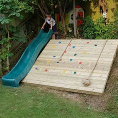 A slide and climbing wall is a perfect way to change a muddy bank into a useable child friendly space. Installed by Clipper Garden Services Backyard Slide, Sloped Backyard, Sloped Garden, Backyard Playground, Backyard For Kids, Backyard Games, Outdoor Games, Child Friendly Garden, Kid Friendly Backyard