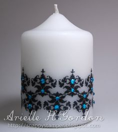 DIY decorated candle - stamp on tissue paper, wrap with wax paper, use hair dryer to 'melt', tissue paper will adhere to candle, then embellish