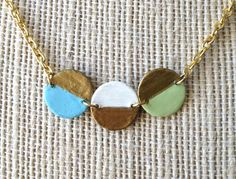colorblock dip dyed circle trio necklace in gold blue white and pastel green. $24.00, via Etsy.