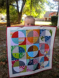 It's as big as my 2 year old.  BTW, he loves it Michelle and he threw a fit when I took it away form him.  Don't really have my usual words for this one.  From Michelle (i like orange too) as part of a private mini quilt swap.  It's the coolest thing I own now.  I had plans to put whatever she made me in my sewing room, but I think this rates the living room, bedroom or dining room.  Everyone must see it.  It is the best.  It is MINE.