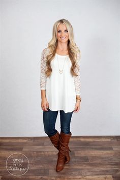 We are in LOVE with our new fabulous blouse for all your upcoming holiday occasions! We love the lace detail on the sleeves, to give this blouse a pop that is sure to have you turning heads! The tunic length is great for leggings, jeans, or dressed up with your favorite pencil skirt! This is sure to be your favorite new go-to blouse, you may need both colors!COLORS BlackIvorySIZES Small 0-4Medium 4-8Large 8-12Model is wearing a size small.