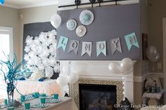 From balloons to the banner to the snowflakes, the decor subtly provides the Frozen look. Source: Genie Leigh Photography