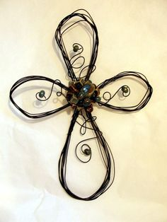 wire cross with aqua, brown,and tan porcelain beads