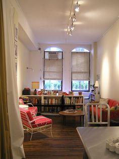 Bed/bedroom hidden behind low bookshelf