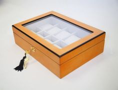 Elegant Oak Wood 10 Compartment Watch Display Case Box with Lock and Key, for Watches and Jewelry by Oineh®, http://www.amazon.com/dp/B00AVO4S62/ref=cm_sw_r_pi_dp_6-47qb0VJDJPH