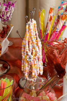 candy necklaces hanging on a jewelry tree