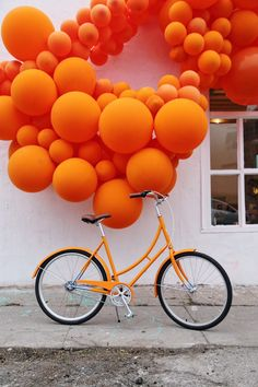 Tangerine balloon art by Geronimo Balloons inspired by our Mayfair cruiser.