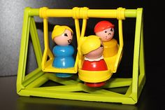 little people swing set by fischer price! I had this! and the sea-saw