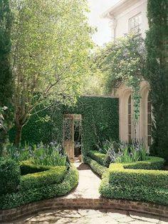 Border around flower beds.  French Design in Houston: Pam Pierce