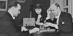 David Oistrakh and Sergei Prokofiev in a game, with 18-year-old violinist Elizabeta   Gilels, daughter of piano great Emil Gilels, watching the game. Judging from Prokofiev's   attire, he was on his way to a concert... (thanks to R. Krishnan, Kuala Lumpur for   identifying the young lady)