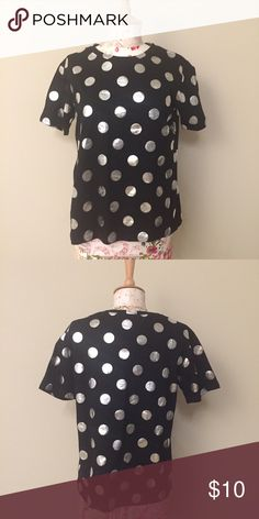 Black and silver polkadot tee Black and silver polkadot tee! New with tags, never worn, size M. Perfect for layering. ***not actually kate spade but similar in polka styling*** kate spade Tops Tees - Short Sleeve