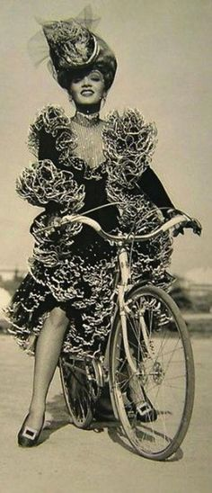 Marlene Dietrich | That could have been me. I'm sure I've ridden a bike in high heels & a party dress.