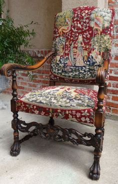 Beautiful tapestry cover on antique chair.