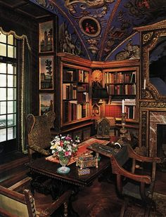 A very elegant and detailed den-library. 19th century, with much detail to the ceiling and walls. Lovely work.