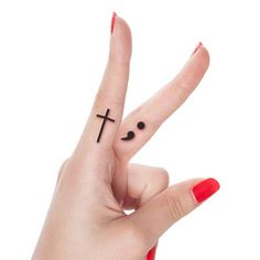Semicolon and cross tattoo