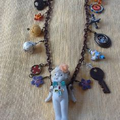 Jewelry. Vintage frozen Charlotte doll necklace I made today with antique beads and old toys
