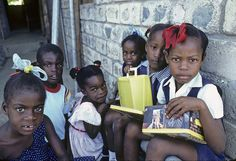 Children at an outdoor class run by the local community for the children of squatters in Kingston, Jamaica. Photo ID 316557. 01/01/1986. Kingston, Jamaica. UN Photo/Milton Grant. www.unmultimedia.org/photo/
