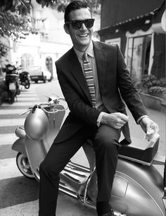 Guy in suit on a moped - Sleek, Stylish, Black and white, Sunglasses