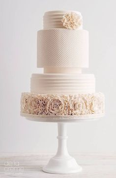 Elegantly simple blush wedding cake with textured floral design; Featured Cake: De la Creme Studio